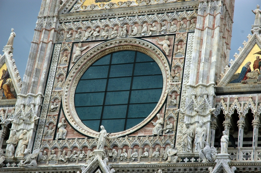 A close-up detail of the elaborate carvings on the Siena duomo.