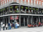 A corner building with ironwork balcony in the French Quarter